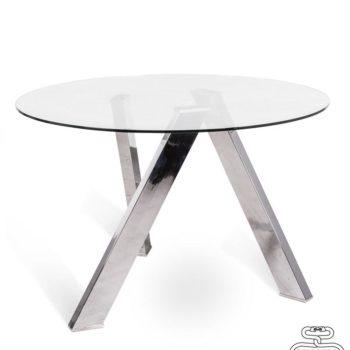 tavolo rotondo in vetro al centro dell'arredamento ligure
